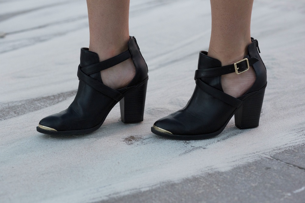 black booties with gold accents