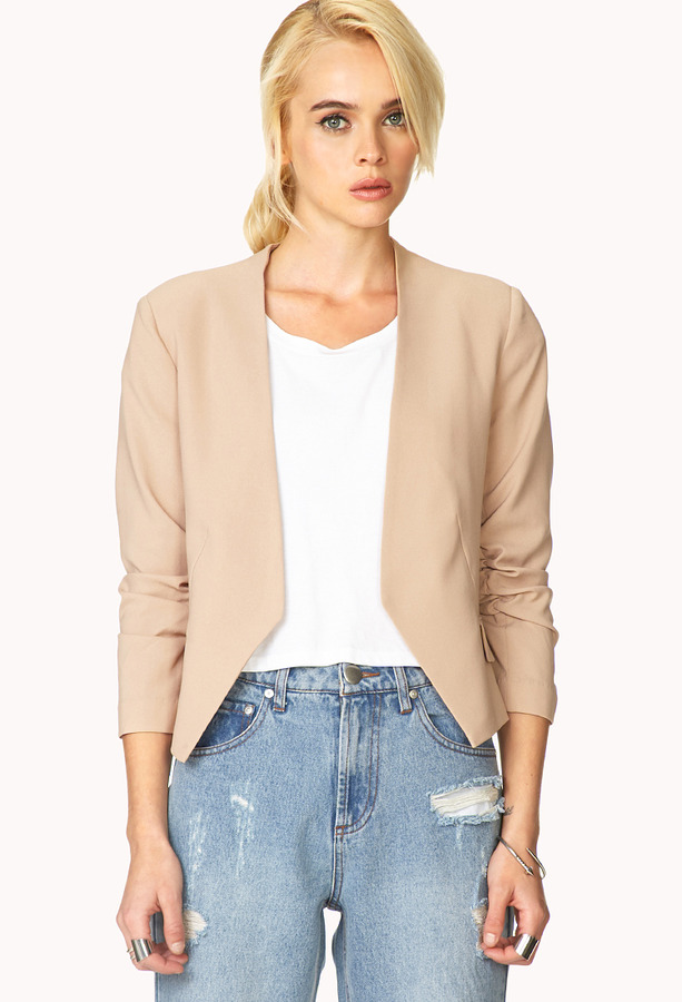 beige collarless blazer